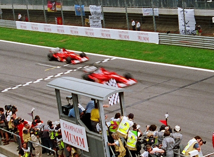 Rubens Barrichello allows Ferrari teammate Michael Schumacher past ahead of the finish line for the 2002 Austrian Grand Prix (by Paddy Briggs [Wikimedia Commons])