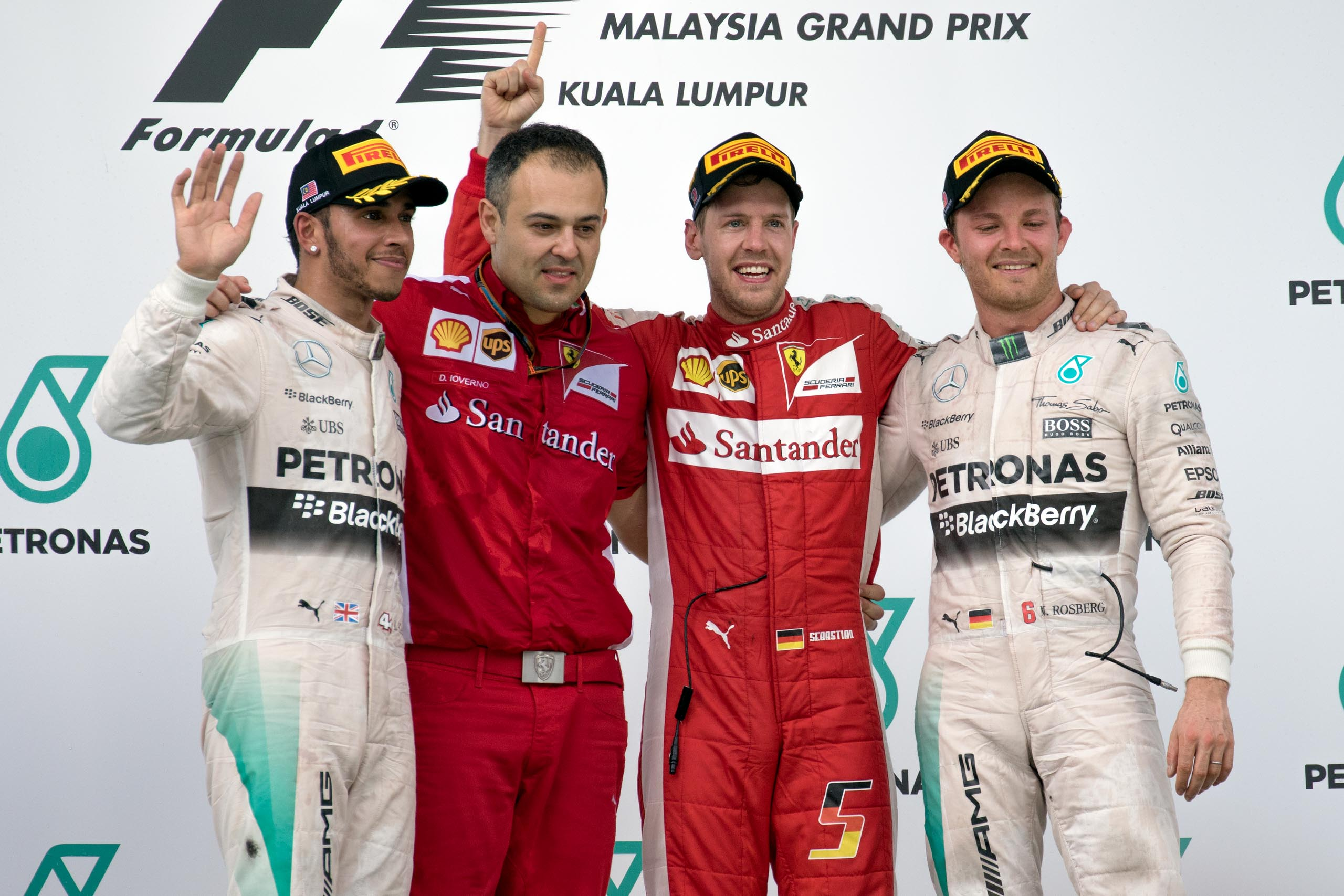Malaysian Grand Prix 2015 podium: from left - Lewis Hamilton of Mercedes, a Ferrari team representative, Sebastian Vettel of Ferrari, and Nico Rosberg of Mercedes